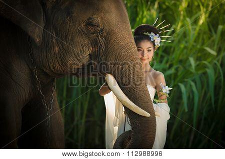 Beauty Asian Woman With Elephant Fashion Portrait
