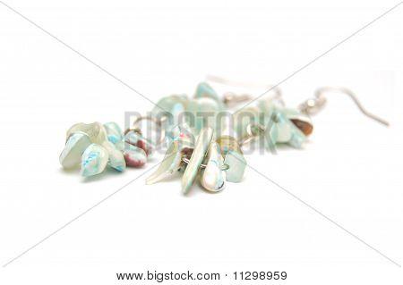 earrings in white background