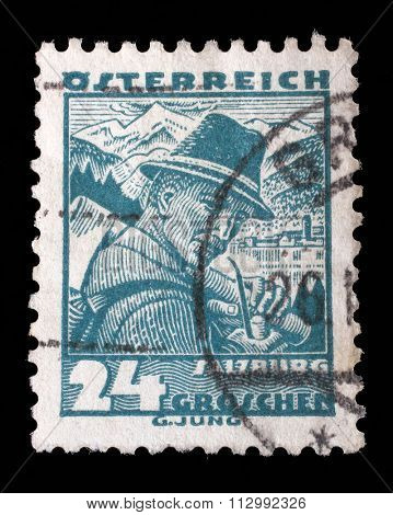 AUSTRIA - CIRCA 1934: A stamp printed in Austria shows a man in the Austrian national dress with the inscription