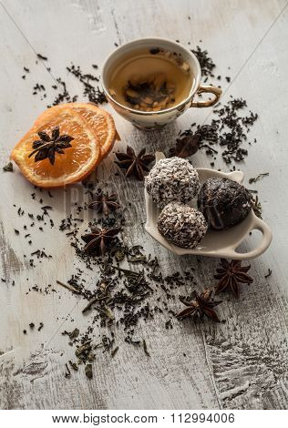 Tea, Dried Cinnamon, Vegan Cookies ,orange And Anise On Wooden Background