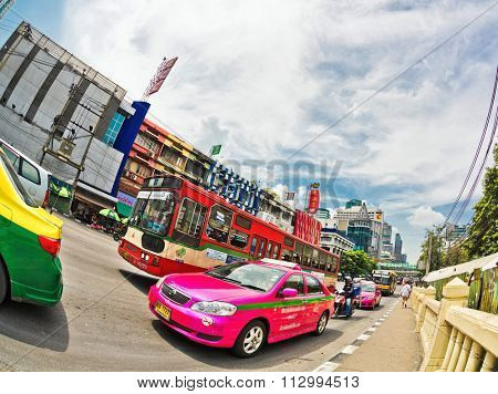 BANGKOK, THAILAND - APRIL 30, 2015: Taxis in Bangkok are looking for passengers. There are 150,000 taxis in Bangkok. All are metered with the starting fee of 35 Baht for the first 3 kilometers.