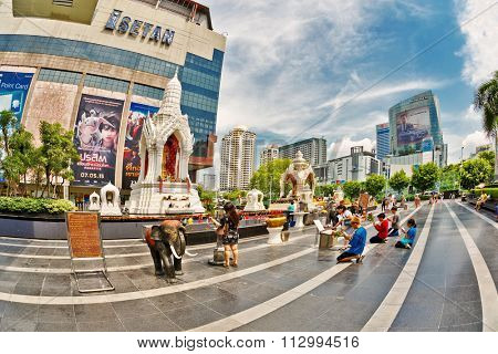 BANGKOK, THAILAND - APRIL 30, 2015: Thais pray about Isetan shopping mall in Central World Plaza. Theravada Buddhism is traditional in Thailand, tradition practiced 95% of the inhabitants of Thailand