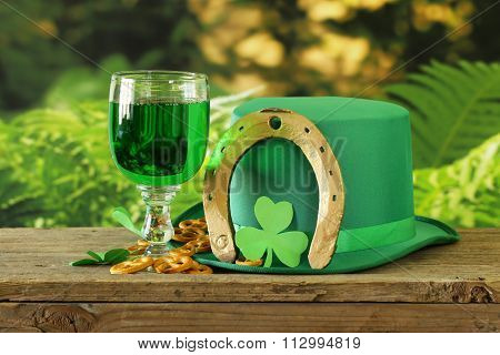 traditional symbols for Patrick's Day - green beer, horseshoe and clover