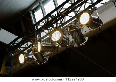 Bright Floodlights Attached To A Steel Frame. Horizontal View Of Yellow Floodlights Attached To A Fr