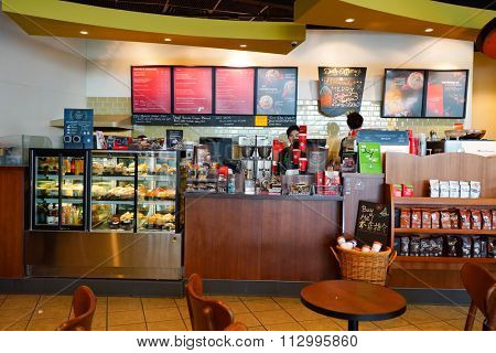 HONG KONG - DECEMBER 24, 2015: interior of Starbucks cafe. Starbucks Corporation is an American global coffee company and coffeehouse chain based in Seattle, Washington