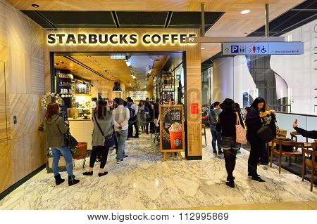 HONG KONG - DECEMBER 25, 2015: interior of Starbucks cafe. Starbucks Corporation is an American global coffee company and coffeehouse chain based in Seattle, Washington