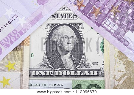 banknotes euro and dollar in the form of  house
