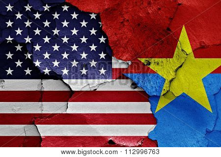 Flags Of Usa And Viet Cong Painted On Cracked Wall