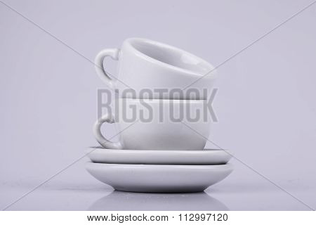 set of ceramic cups on a white background