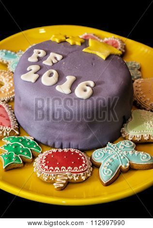 Detail Of Festive Cake With The Title Pf 2016 And Various Gingerbread Cookies