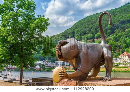HEIDELBERG, GERMANY - MAY 28, 2015: Bronze sculpture of a monkey on the old bridge in Heidelberg.