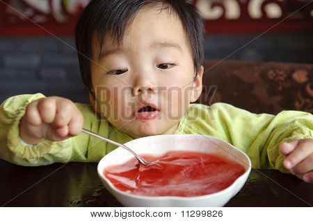A Cute Baby To Drink Soup