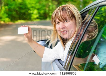 Female Driver Showing A Blank Card