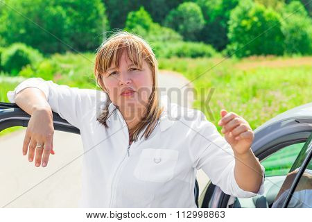 Mature Driver Near Her Beloved Car