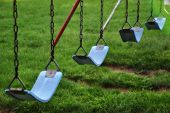 stock photo of swingset  - Swings at a playground in Canton - JPG