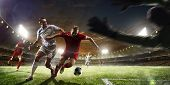 Soccer players in action on sunset stadium background panorama poster