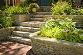 foto of planters  - Natural stone landscaping in home garden with stairs - JPG