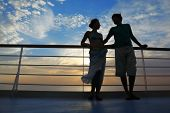 man and woman on deck of cruise ship.