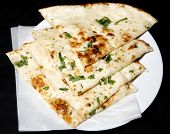 stock photo of punjabi  - fresh and hot tandoori naan in plate for lunch - JPG