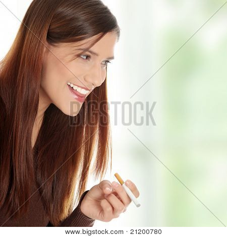 Young woman smoking electronic cigarette (ecigarette)