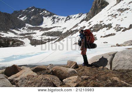 Backpacker By Frozen Lake