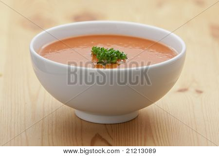 Spanish cold tomato based soup gazpacho served in a white bowl