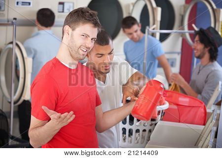 Confused Young Man In Laundromat