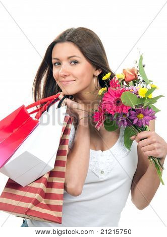 Woman Holding Shopping Bags, Presents And Bouquet Of Flowers