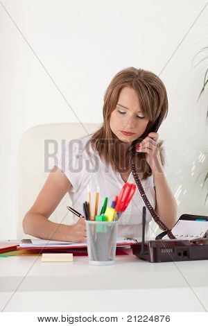 Businesswoman Speaks  By Phone At The Office.