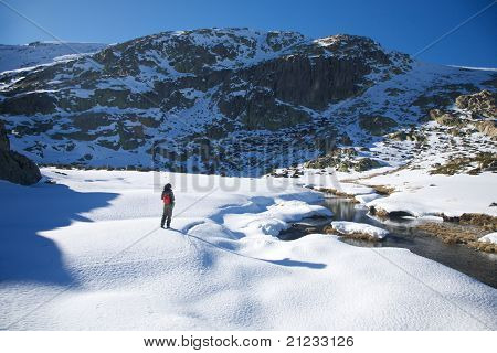 Hiking Woman On Snow Valley