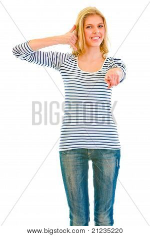 Smiling teen girl showing contact me gesture and pointing finger at you isolated on white