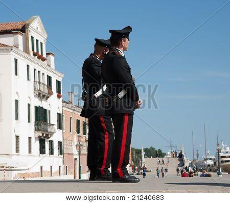 Two police, Italian carabanieri.