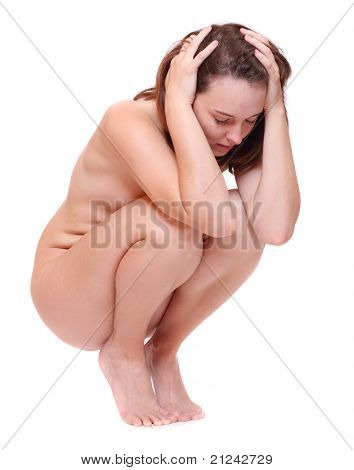 Worried woman sitting on a white background.