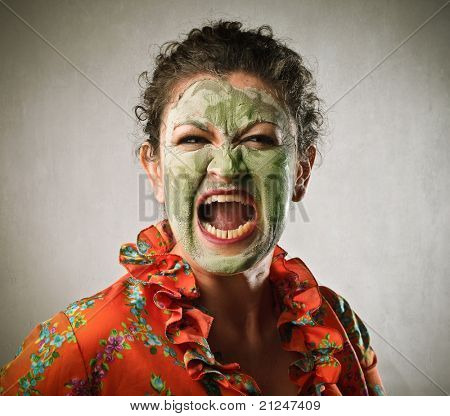 Angry woman wearing a face mask and screaming