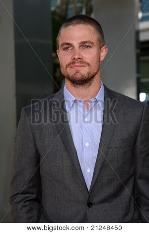 LOS ANGELES - JUN 21:  Stephen Amell arrives at the True Blood Season 4 Premiere at ArcLight Theater on June 21, 2011 in Los Angeles, CA