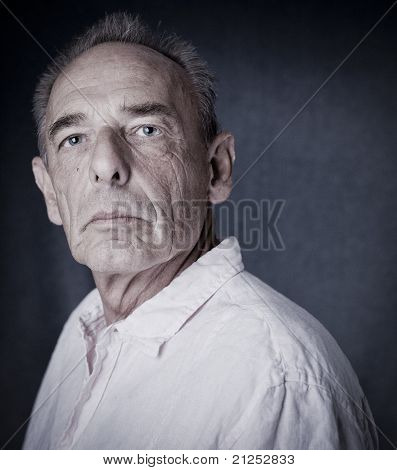 Winner pose of an old man (senior)