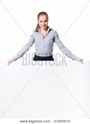 Businesswoman standing behind blank