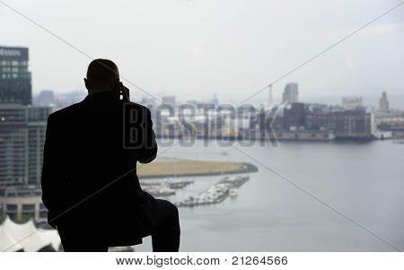 Bald Man In Window On The Phone