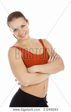 Smiling young sporty woman. Isolated over white background