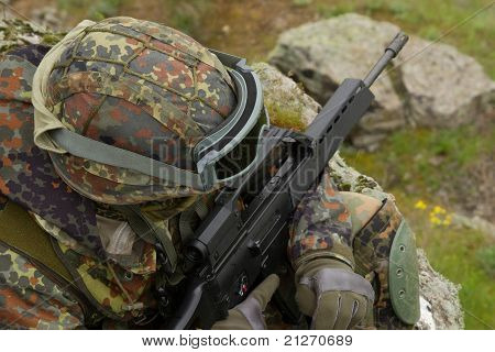 Soldier With A Rifle Sitting