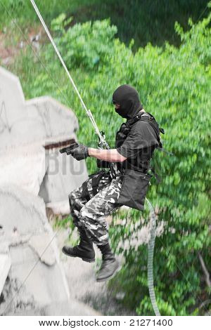 Armed Soldier Rappelling