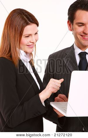 businessman and businesswoman with laptop standing in white background