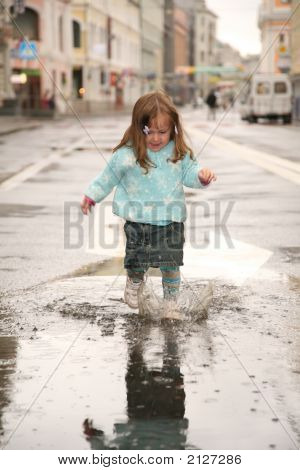 Girl In Puddle