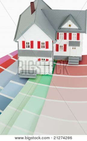 A Maniature House On A Color Chart