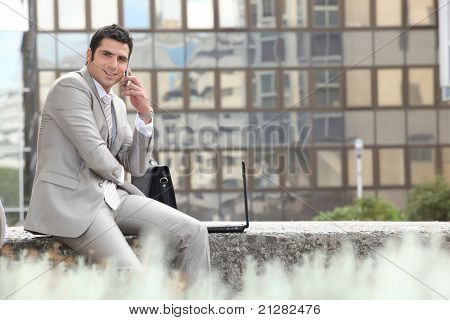 Businessman escaping the office