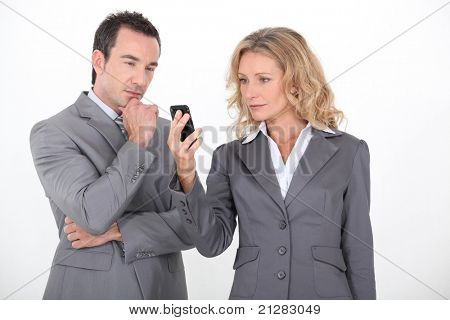 Businesspeople expecting a message on phone