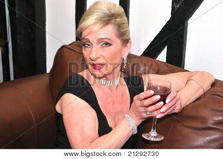 Senior Woman Enjoying A Drink