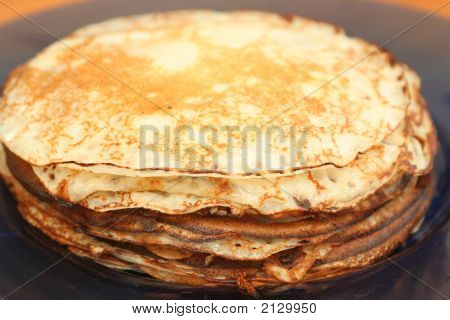 Many Pancakes Lay In A Plate