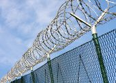 stock photo of anti-terrorism  - Fence with a barbed wire - JPG