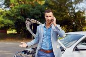 Man Stands Next To A Broken Car Calling poster